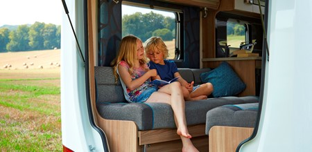 Two children in motorhome